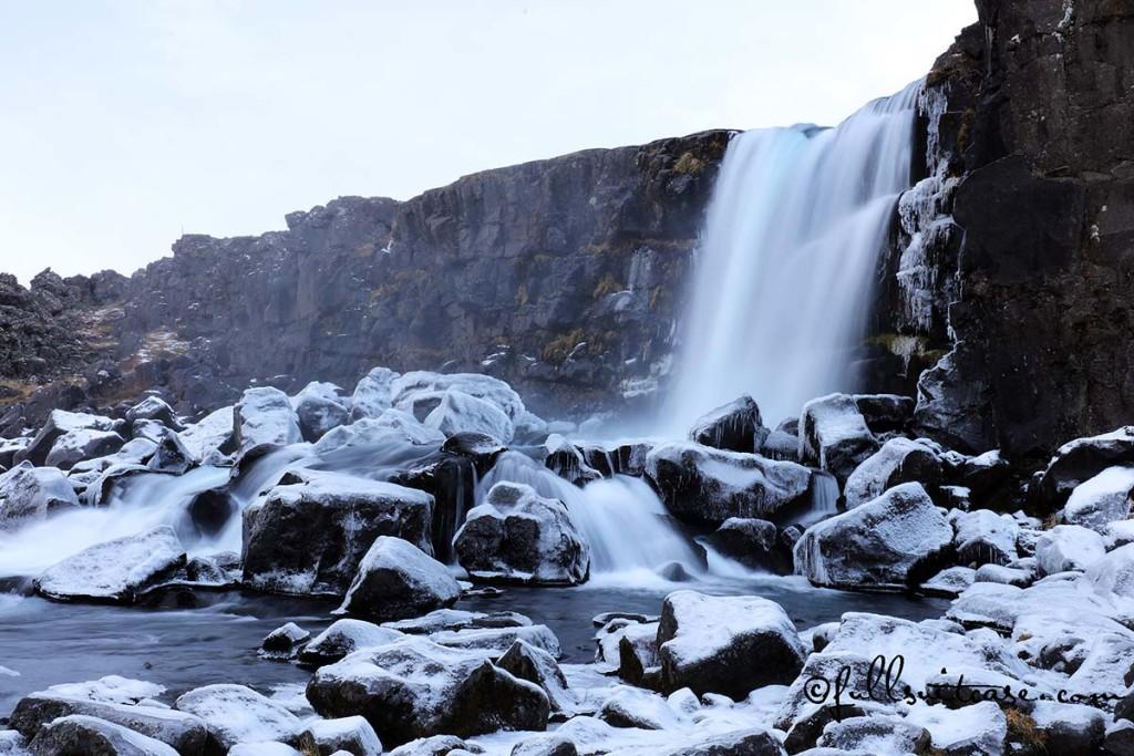 Winter waterfall in Thingvellir Iceland