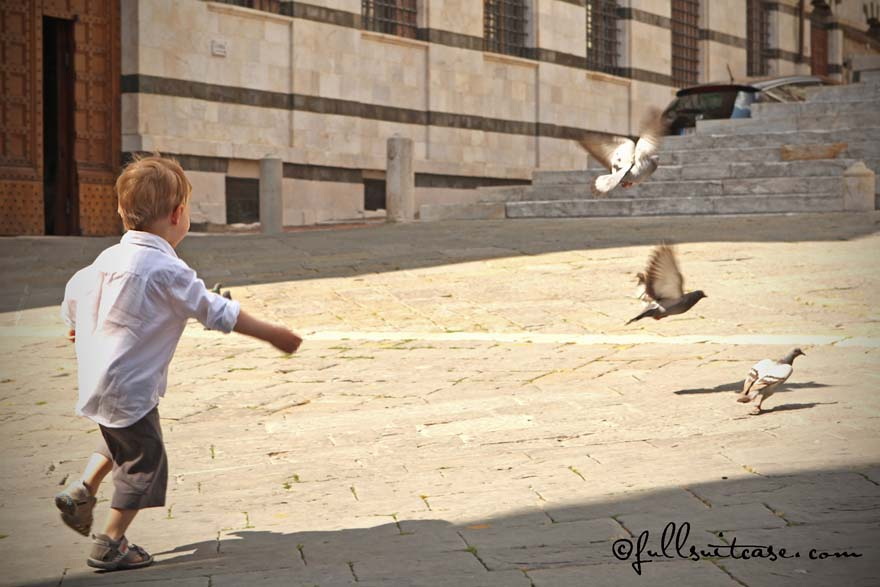 traveling with young children - chasing pigeons in Italy