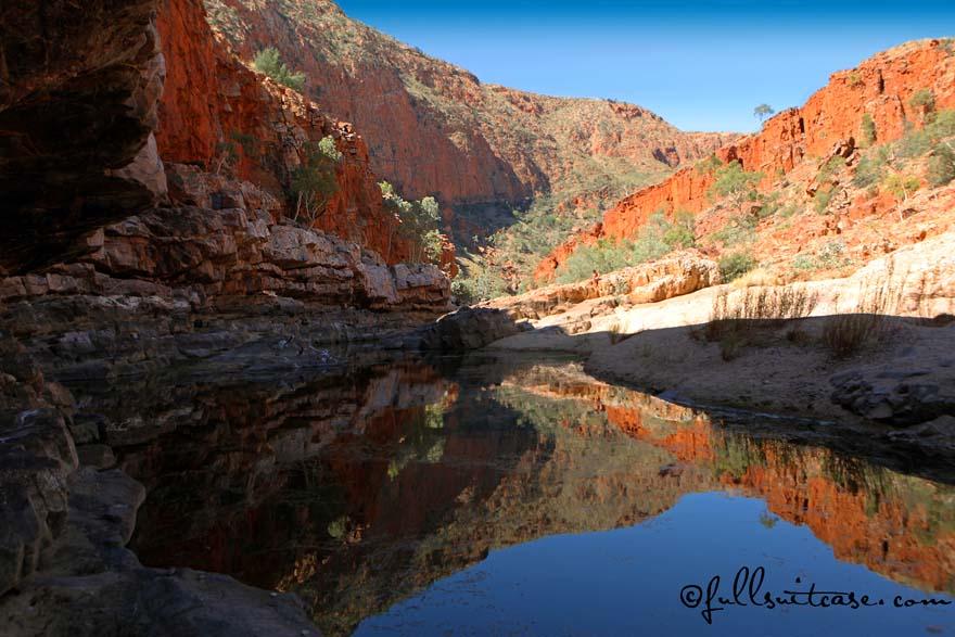 Mountain reflections in the waterhole of Ormiston Gorge Australia