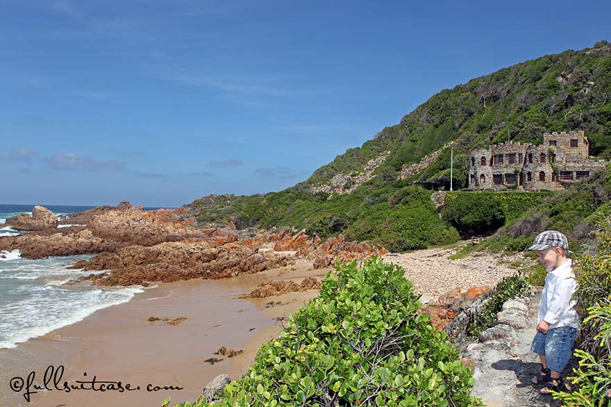 Young boy walking on a coastal path of Noetzie Beach near Knysna