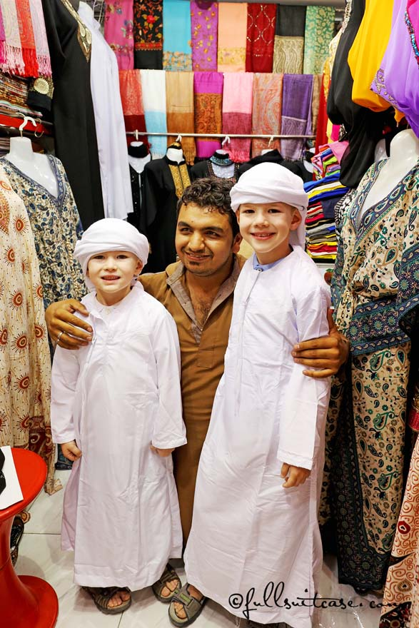 Children tourists wearing local traditional outfits in Dubai