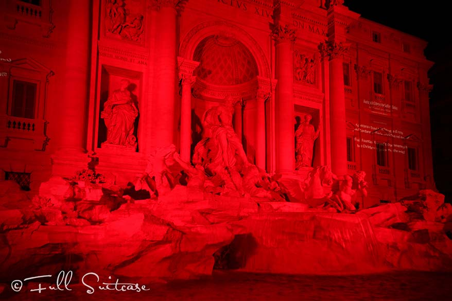 Trevi fountain at night in red in memory of the persecuted Christian martyrs
