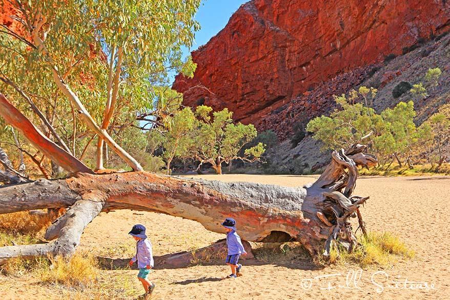 Kids exploring Simpsons Gap in West MacDonnell Ranges Australia