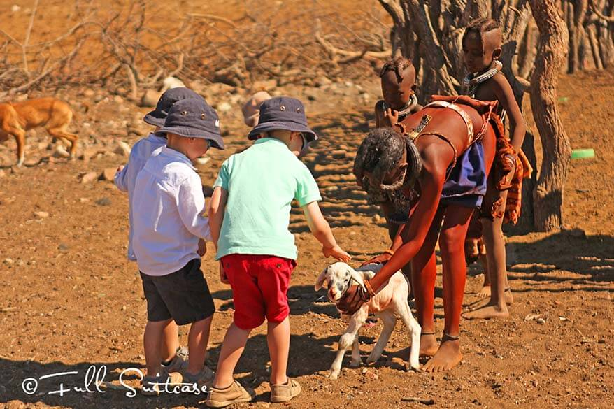 Kids playingwith local Himba children in Namibia