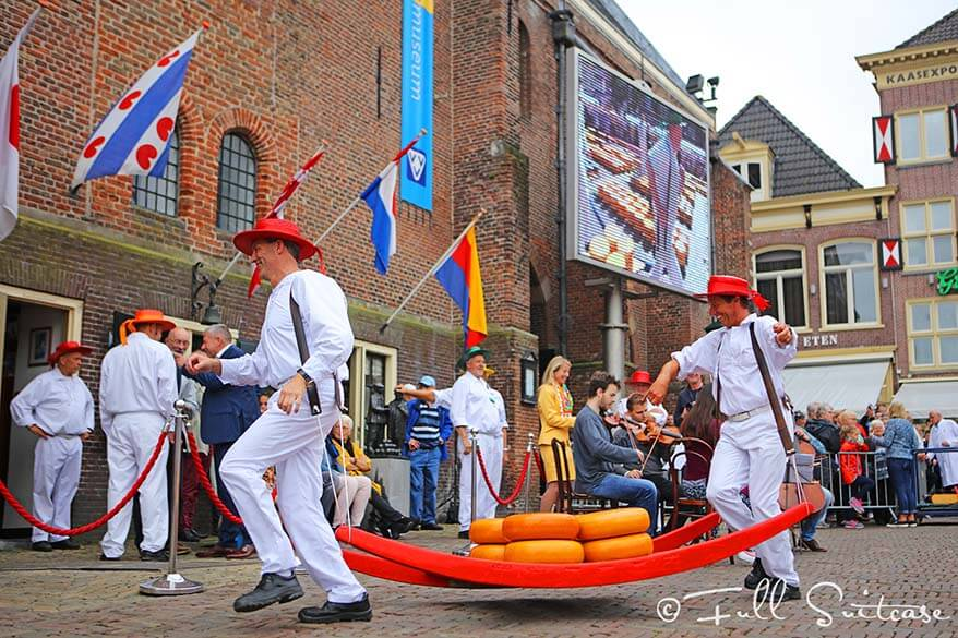 Cheese carriers seem to really enjoy their job at the Alkmaar cheese market