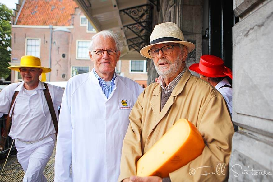 Cheese samplers and traders at Alkmaar cheese market