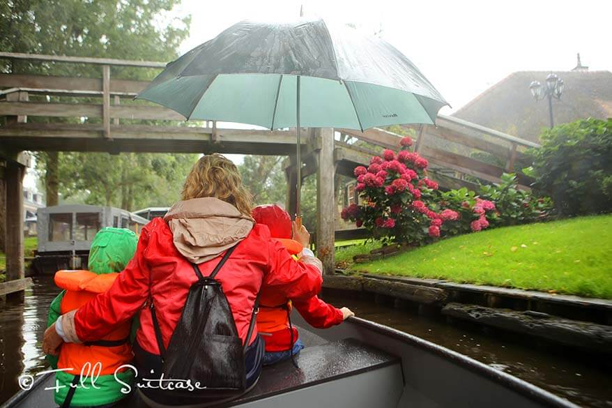Riding a boat in the rain in Giethoorn Netherlands