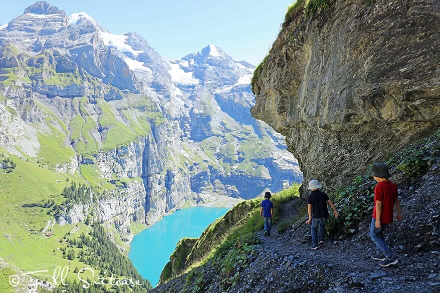 Children hiking at Oeschinensee in Switzerland