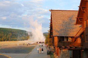 Old Faithful Inn and Geyser in Yellowstone National Park