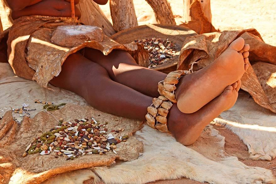 Damara woman making traditional jewellery - Namibia