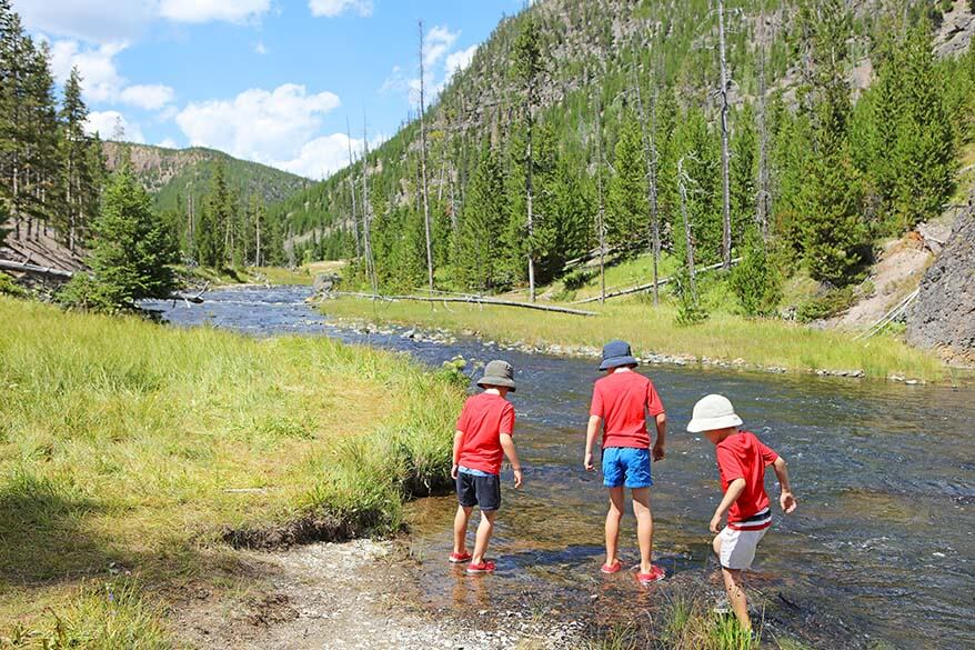 Kids playing in Gardner river in Yellowstone in summer