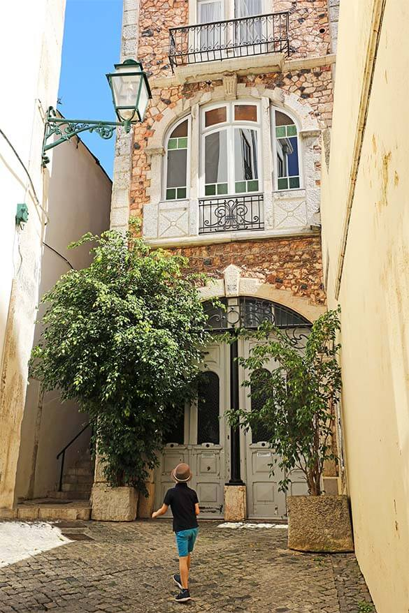 Walking the narrow streets of Alfama district in Lisbon