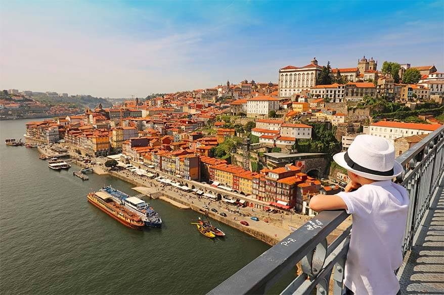 Admiring the view over the old town in Porto, Portugal with kids