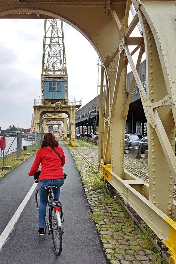 Exploring Scheldt river quays in Antwerp by bike