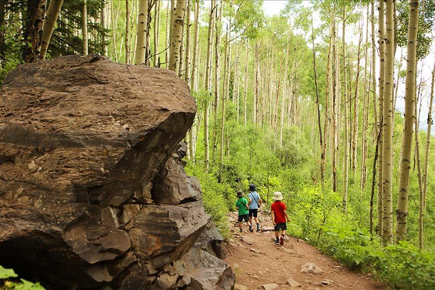 Hiking through the aspen forest on the Crater Lake Trail at Maroon Bells with kids