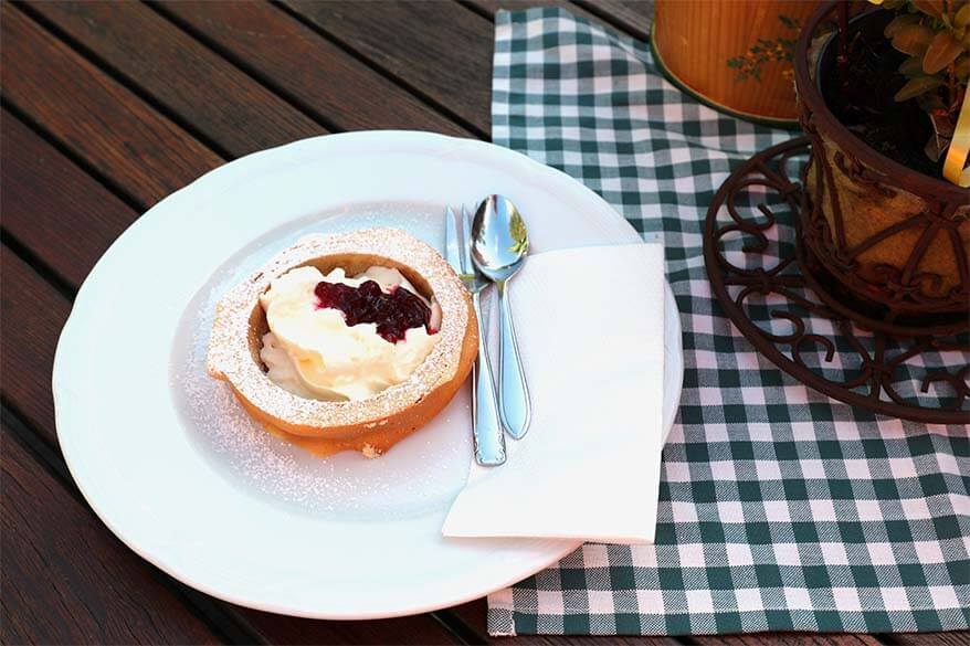 Austrian Prugeltorte served with whipped cream and cranberry sauce
