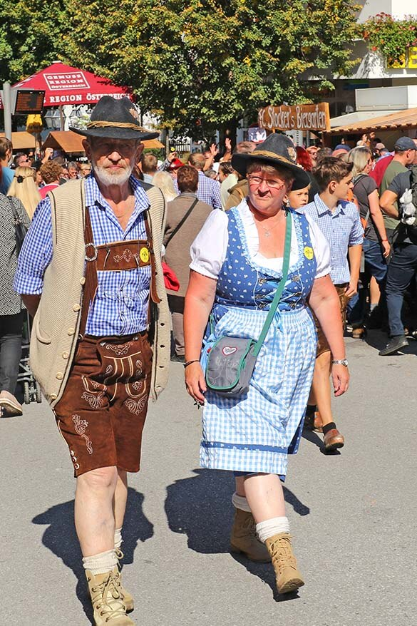 Local people in traditional Tyrollean outfits - dirndl and lederhosen