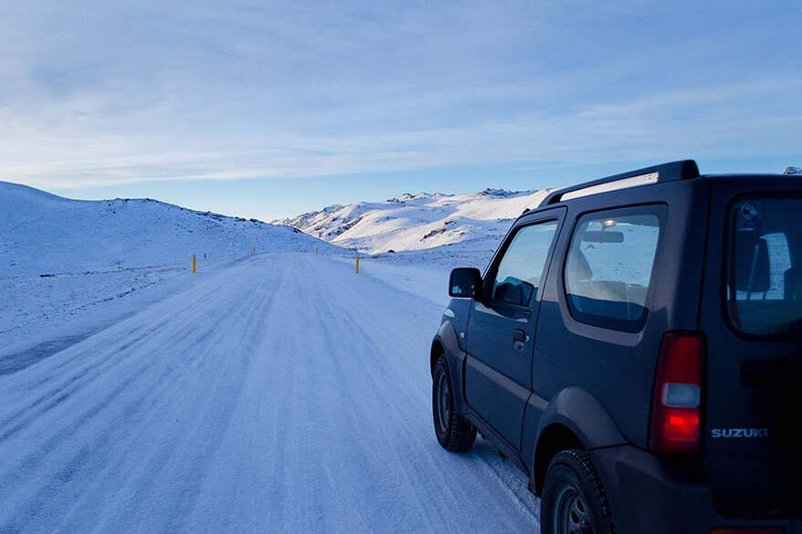 Small 4WD driving on the icy roads in Iceland in January
