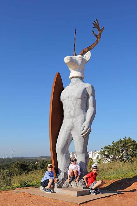 An unusual surfer statue near Nazare lighthouse