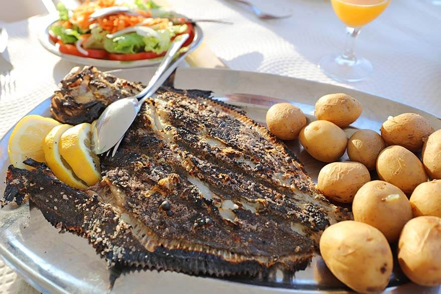 Dinner with catch of the day in a local restaurant in Nazare Portugal