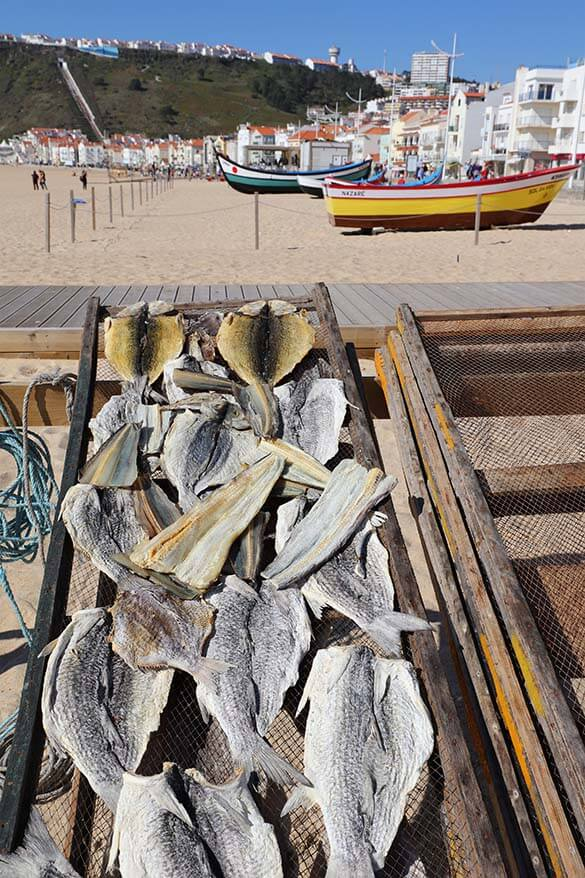 Fish drying on the wooden racks in Nazare beach Portugal