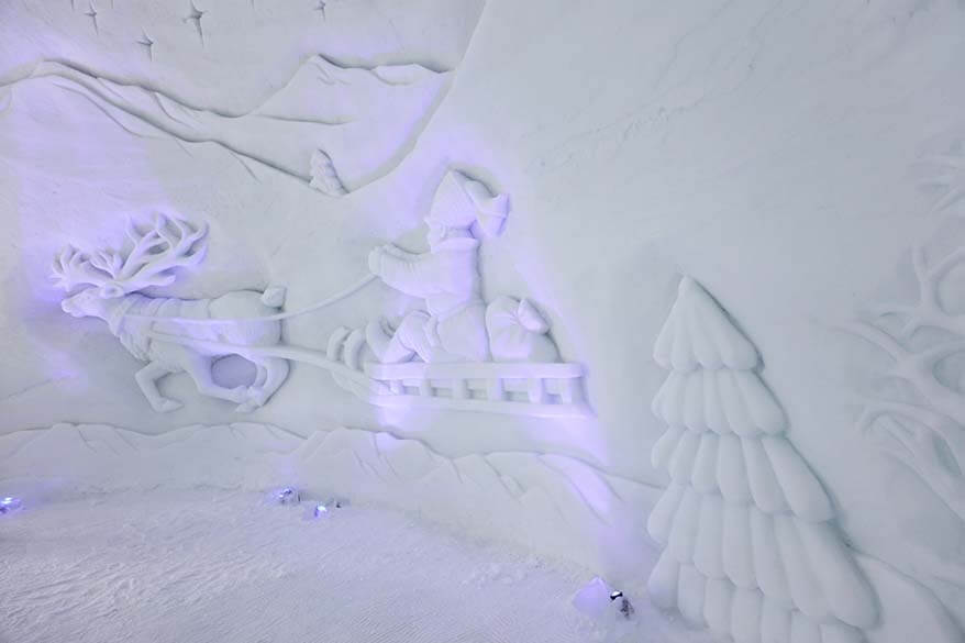 Sami on the reindeer sled ice carving - this image is probably the predecessor of Santa Claus