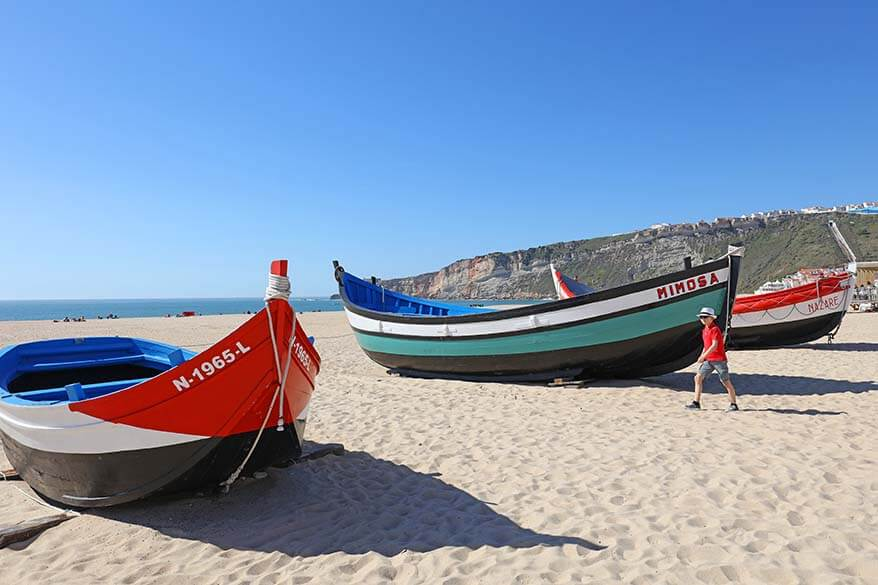 Traditional wooden fishing boats on a beach in Nazare Portugal