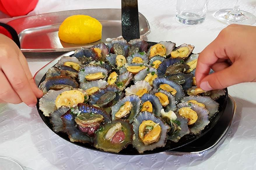Eating limpets at a local restaurant in Madeira