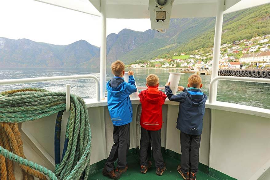 Kids on a fjord safari in Norway in summer