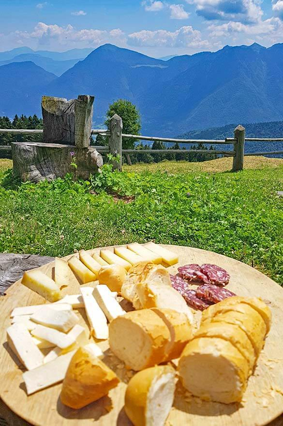 A plate of cheese, bread, and meat at a local dairy farm in Trentino mountains Italy