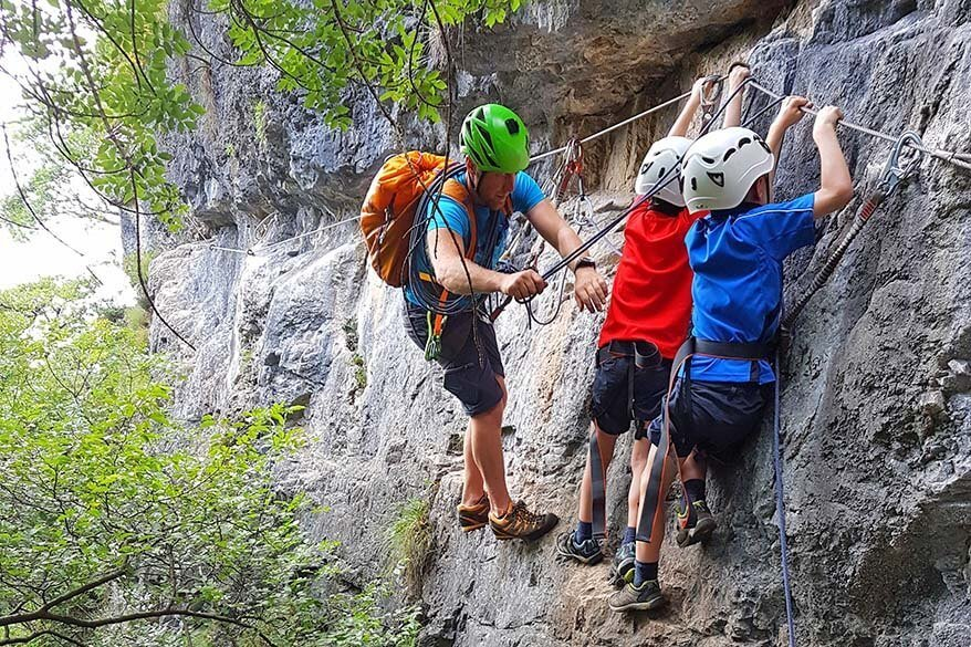 Climbing along Ferrata Preore in Italy with kids