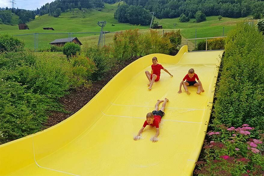 Family water fun at a swimming pool in St Anton am Arlberg in Tyrol