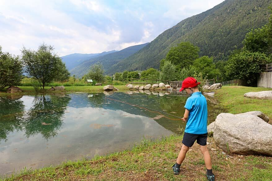 Kids fishing in Trentino Italy