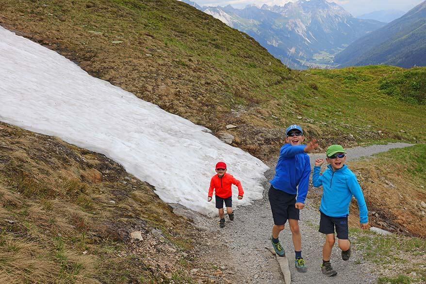 Kids playing - a snowball fight in Austrian Alps in summer