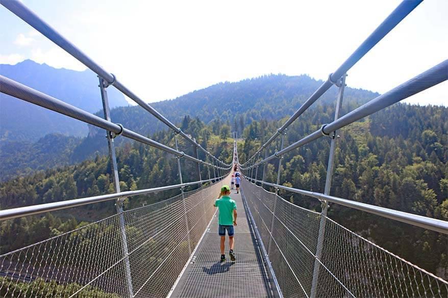 Kids walking on Highline 179 suspension bridge in Austria