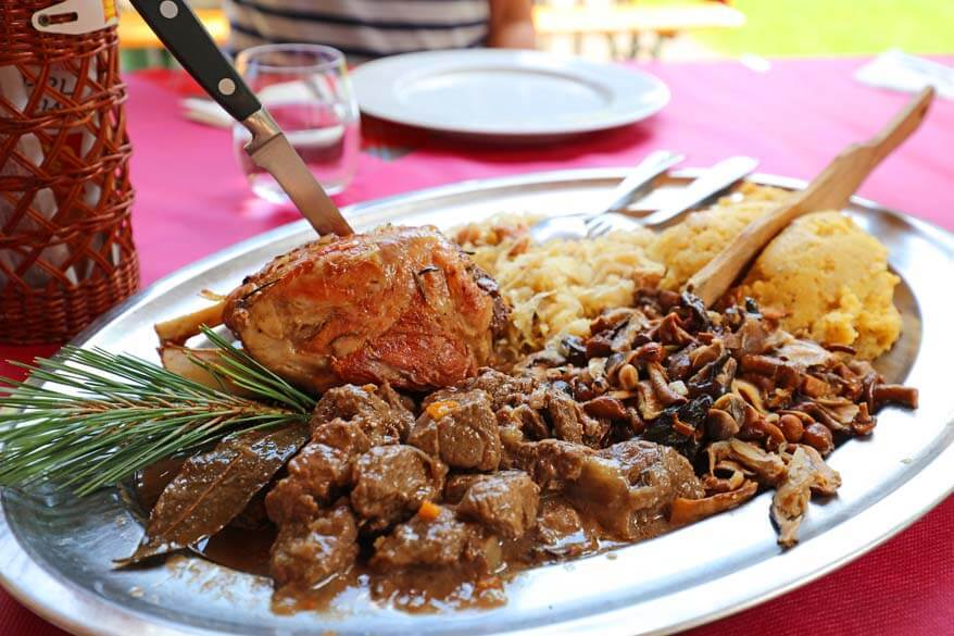 Traditional dish with meat, mushrooms, and polenta in Trentino Italy