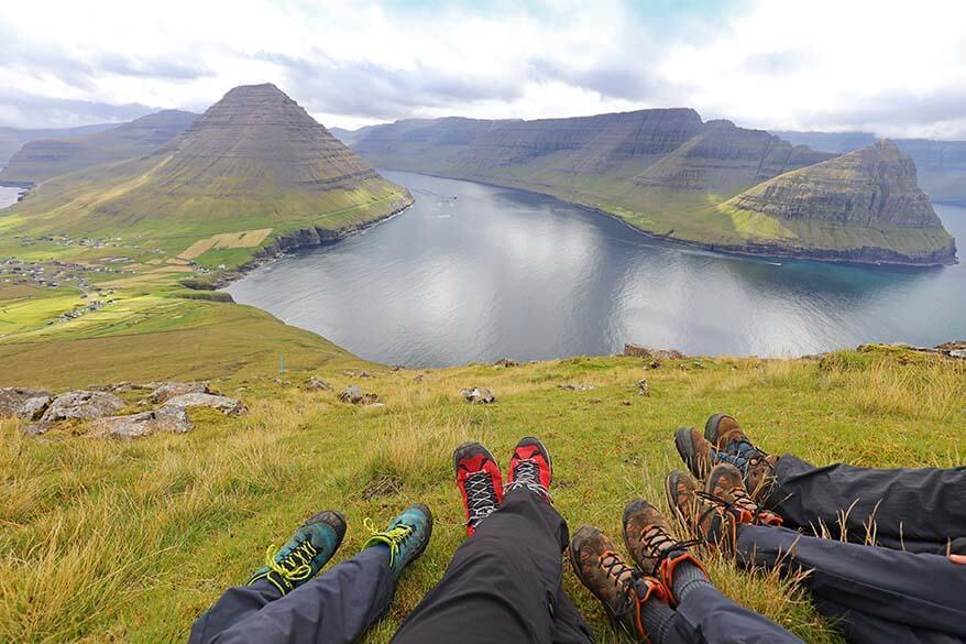 Family hiking in the northern Faroe Islands near Vidareidi village