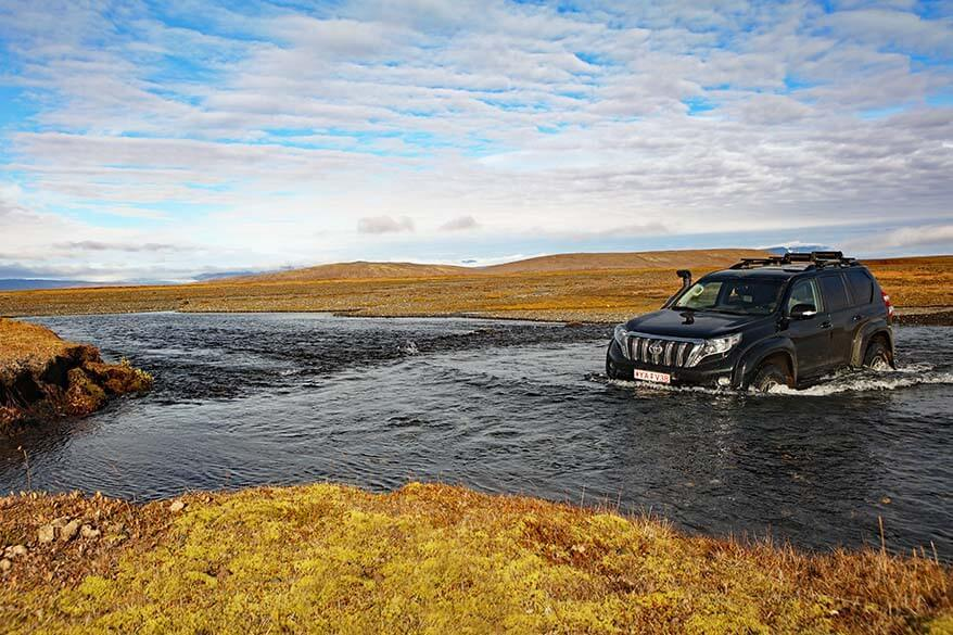 Super jeep crossing a river in the Icelandic Highlands