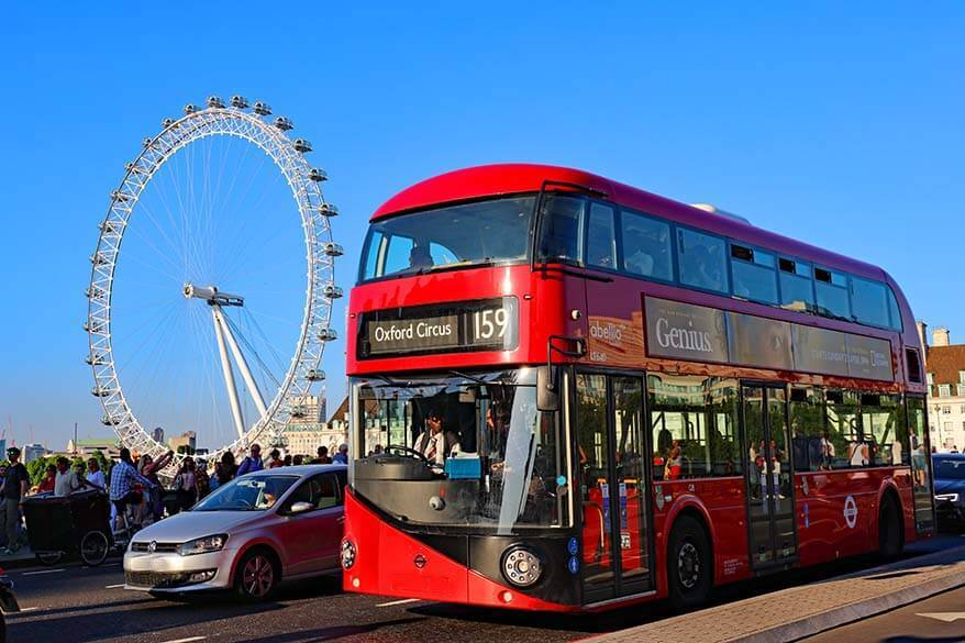 Red double-decker bus on the Westminster Bridge in London