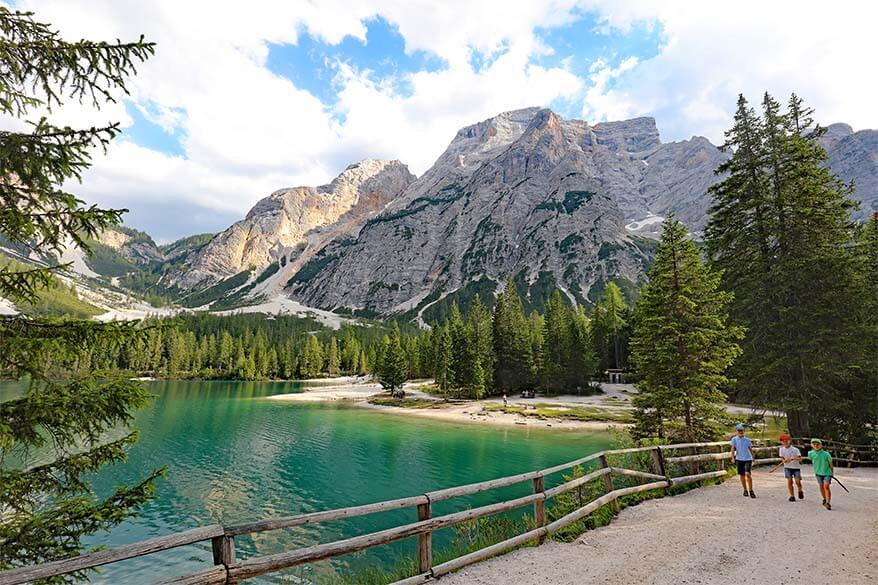 Hiking at Lago di Braies, the most beautiful lake of the Dolomites in Italy