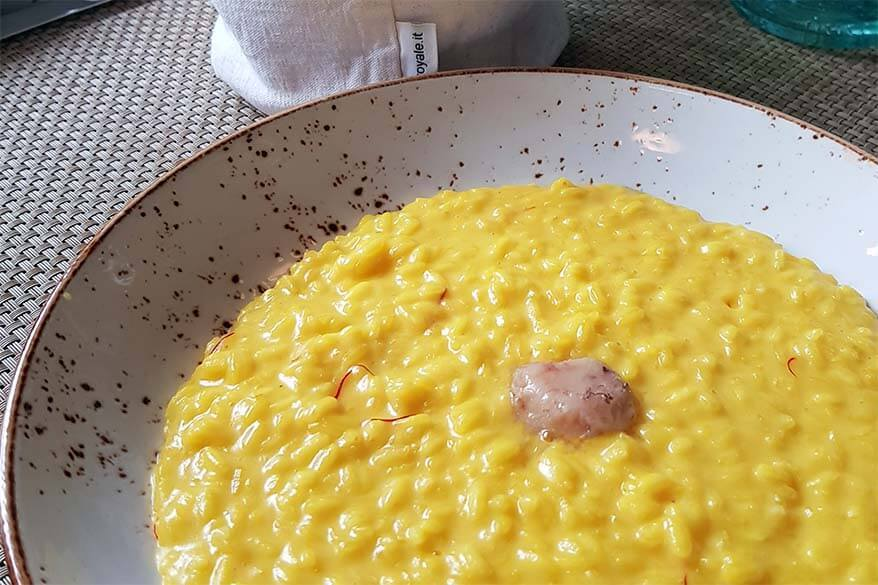 Risotto alla Milanese con midollo - typical dish in Lombardia region in Italy