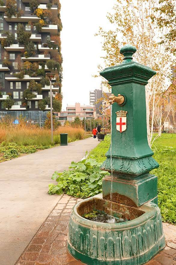 Traditional Italian water tap in a modern Porta Nuova district in Milan