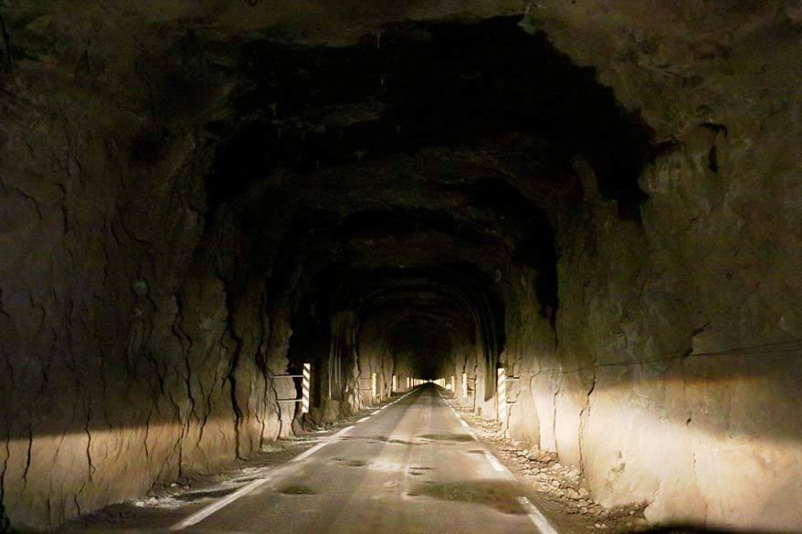 Driving in the Faroe Islands - narrow dark tunnel on Kalsoy island