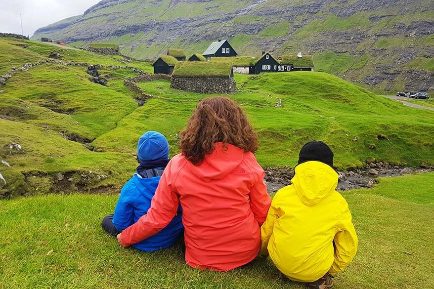 Family in Saksun village on the Faroe Islands - even in summer, you need to dress really warm