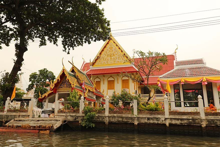 Colorful temple along Khlong Bangkok Yai as seen from the boat on the canal tour