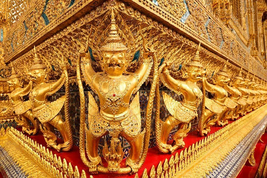 Golden exterior detail of the Emerald Buddha Temple in the Grand Palace in Bangkok Thailand