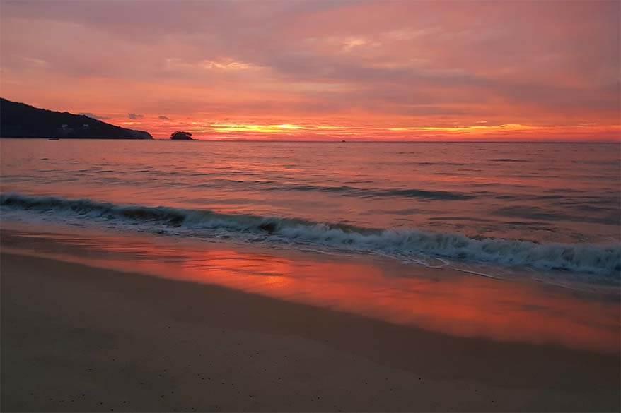 Red sunset at Nai Yang Beach in Sirinat National Park in Phuket Thailand