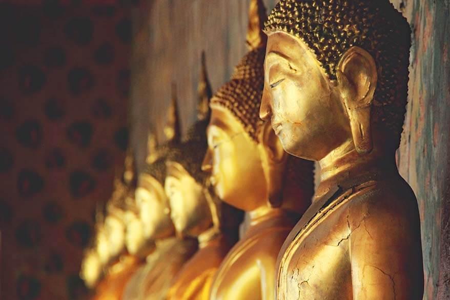 Row of golden Buddha statues at Wat Arun temple in Bangkok Thailand