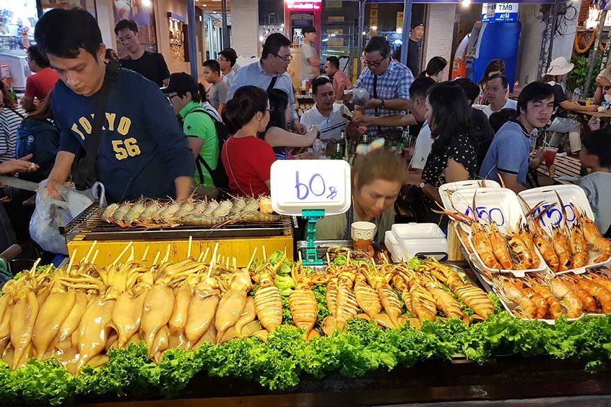 Street food stall selling seafood on Khao San road in Bangkok
