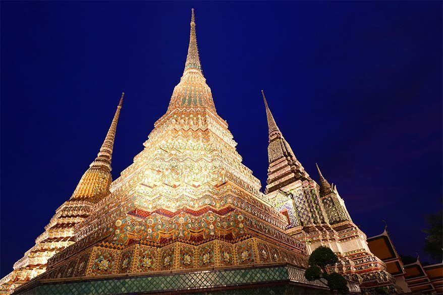 Wat Pho temple in Bangkok lit in the evening